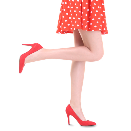 Young woman wearing dress and high heels on white background