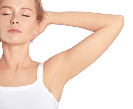 Beautiful young woman on white background. Concept of using deodorant Banque d'images