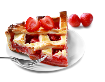 Plate with delicious piece of strawberry pie on white background