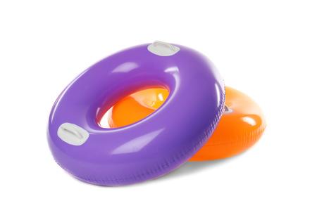 Dos coloridos anillos de natación aislados en blanco Foto de archivo