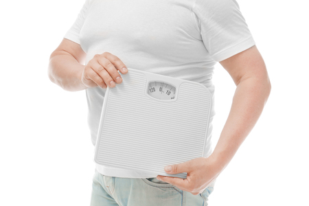 Overweight man holding weight scales on white background. Diet concept