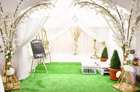 Beautiful wedding decor. Bench and decorations at photo zone 스톡 콘텐츠