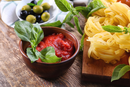 Bowl with tasty tomato sauce for pasta on table 스톡 콘텐츠