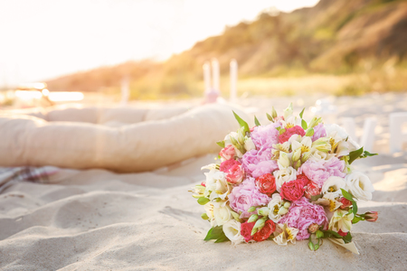 Beautiful wedding bouquet on beach