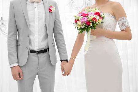 Happy beautiful couple on wedding day, indoors