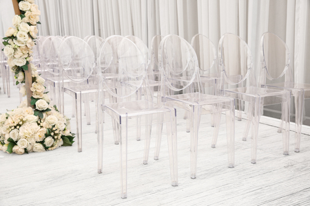 Transparent plastic chairs for guests on wedding ceremony Imagens