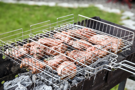 Cooking of appetizing juicy spare ribs outdoors Archivio Fotografico