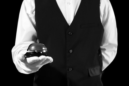 Man holding bell on black background, closeup Banque d'images