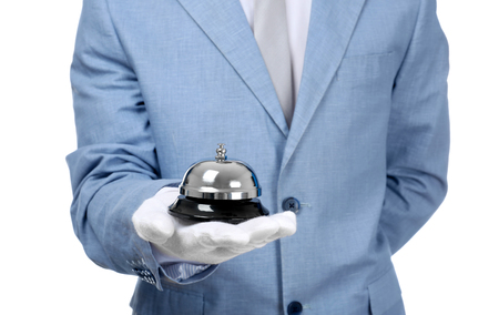 Man holding bell on white background, closeup