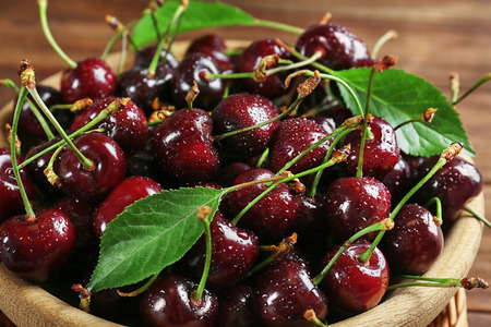 Bowl with fresh sweet cherries, closeup