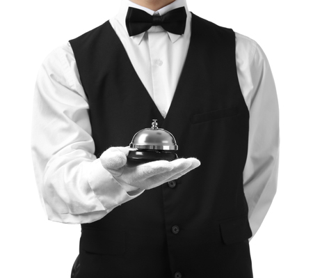 Man holding bell on white background Stock Photo