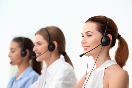 Team of technical support dispatchers working in office Imagens