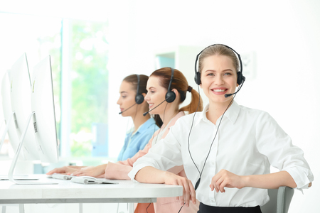 Young female technical support dispatchers working in office