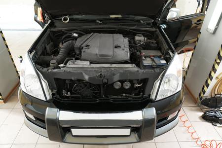 Car with open hood in body shop Фото со стока