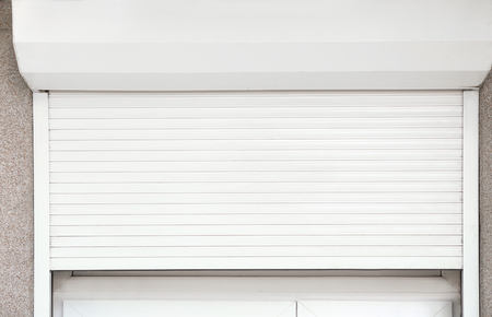 Window with half-closed roller shutter, closeup Banco de Imagens
