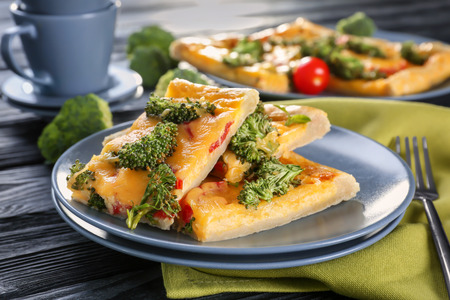 Traditional quiche with broccoli and cheese on plate