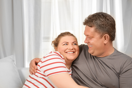 Overweight couple at home Фото со стока