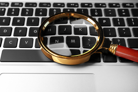 Magnifying glass on laptop. Internet search concept Imagens
