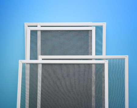 Mosquito window screens on color background