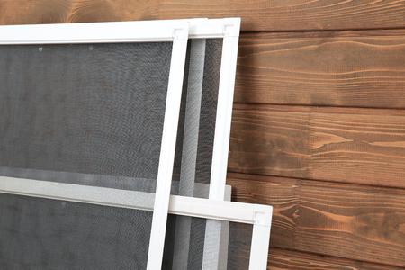 Mosquito window screens on wooden background 版權商用圖片