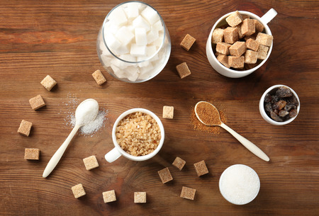 Various kinds of sugar on wooden table