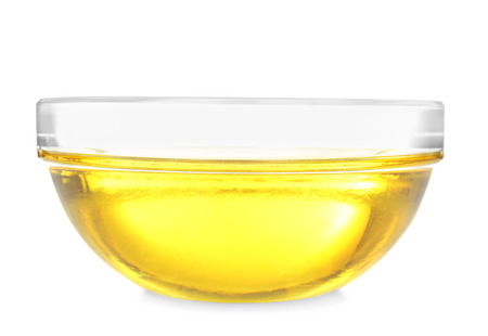 Glass bowl with cooking oil on white background