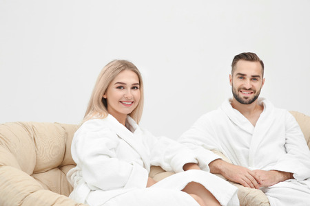 Young couple in bathrobes relaxing indoors Standard-Bild