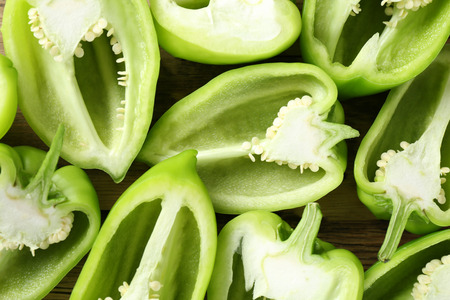 Sliced green peppers as background