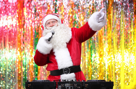 DJ Santa Claus playing music in club Stock Photo