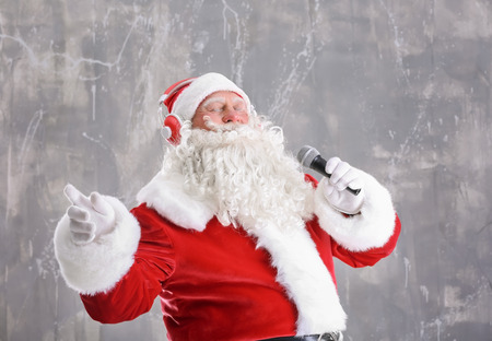Santa Claus singing Christmas songs on grunge background