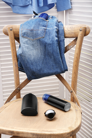 Personal care products for men on chair in room Archivio Fotografico