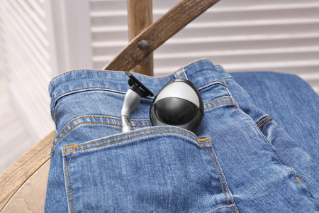 Deodorant and razor in pocket of jeans, closeup Stockfoto