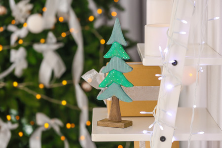Shelf with beautiful decoration for Christmas on blurred background