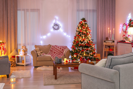 Decorated living room with beautiful Christmas tree