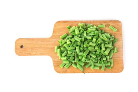 Wooden board with fresh green beans on white background