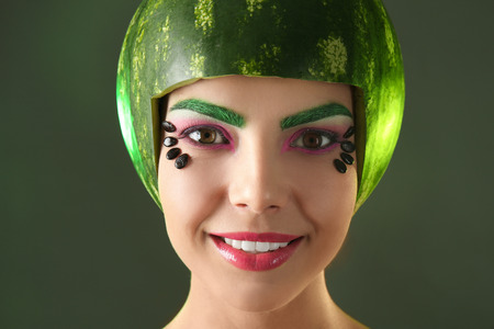 Woman with watermelon helmet on colorful background