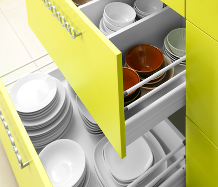 Set of tableware in kitchen drawers Imagens