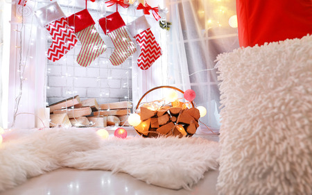 Fireplace decorated for Christmas in living room Stock Photo