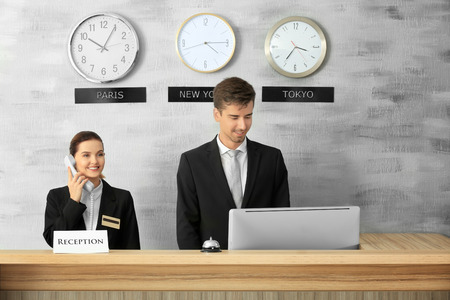 Female and male receptionists working in hotel