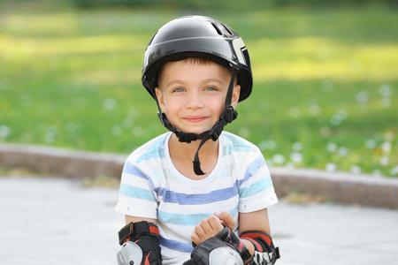 Cute boy in helmet at park