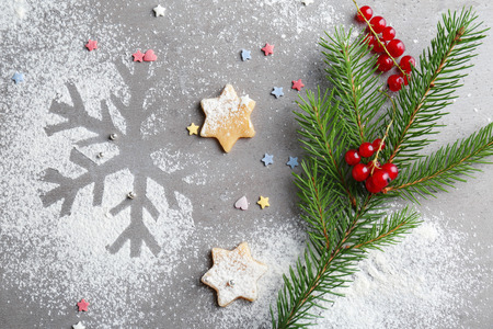 Christmas composition of raw cookies and snowflake on grey background