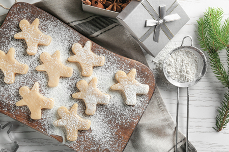 Christmas composition with raw cookies on wooden table