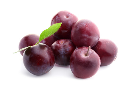 Fresh ripe plums on white background Stock Photo