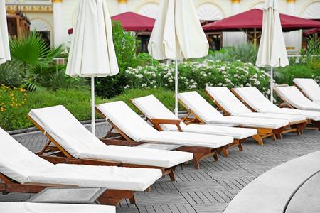 Empty sunbeds at luxury hotel