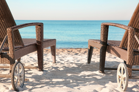 Empty sunbeds on beach near sea