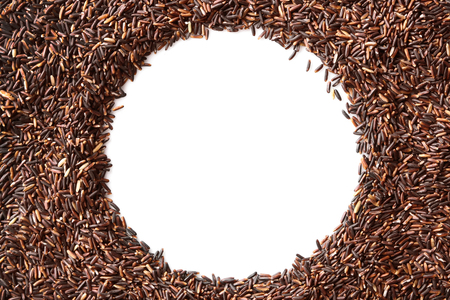 Round frame made with black rice on white background