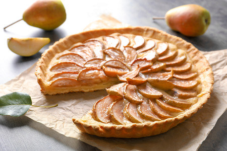 Tasty homemade pear tart on table