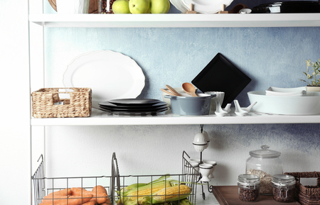 Storage stand with kitchenware indoors