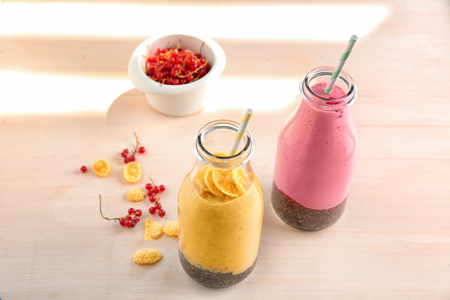 Colorful smoothies with chia seeds in bottles on table 版權商用圖片