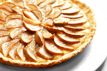 Plate with tasty pear tart, closeup